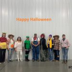 Picture of several IFS employees dressed up in costume for Halloween 2019